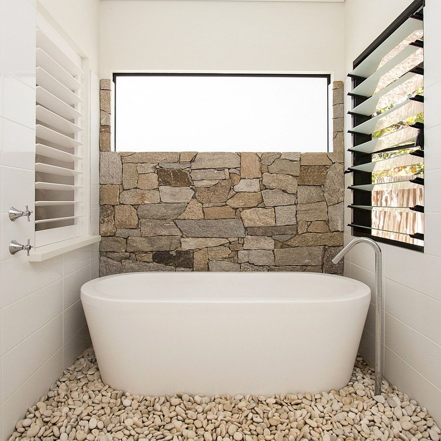 http://www.decoist.com/bathroom-stone-wall-ideas/
